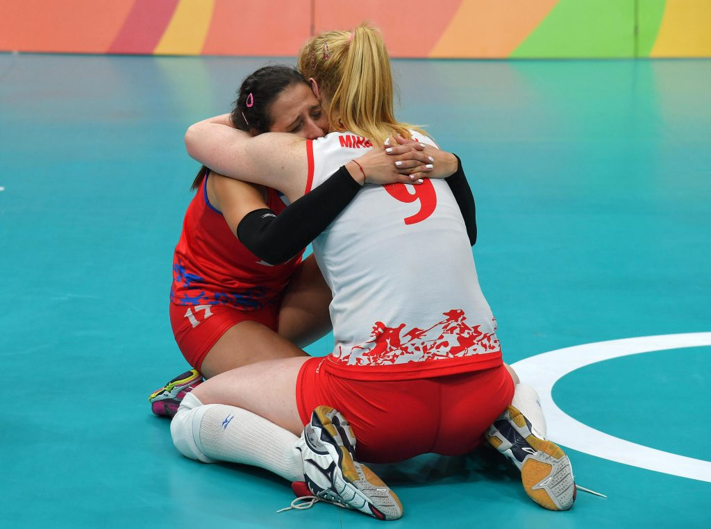 Silvija Popovic and Brankica Mihajlovic of Serbia celebrate for the final